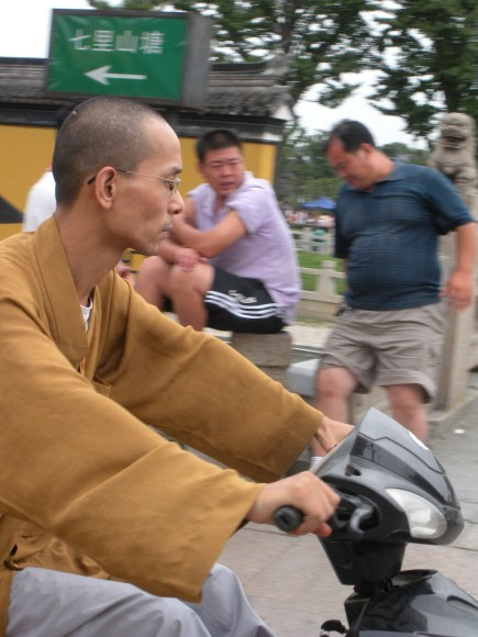 It seems a Buddhist monks preferred mode of transport is a moped
