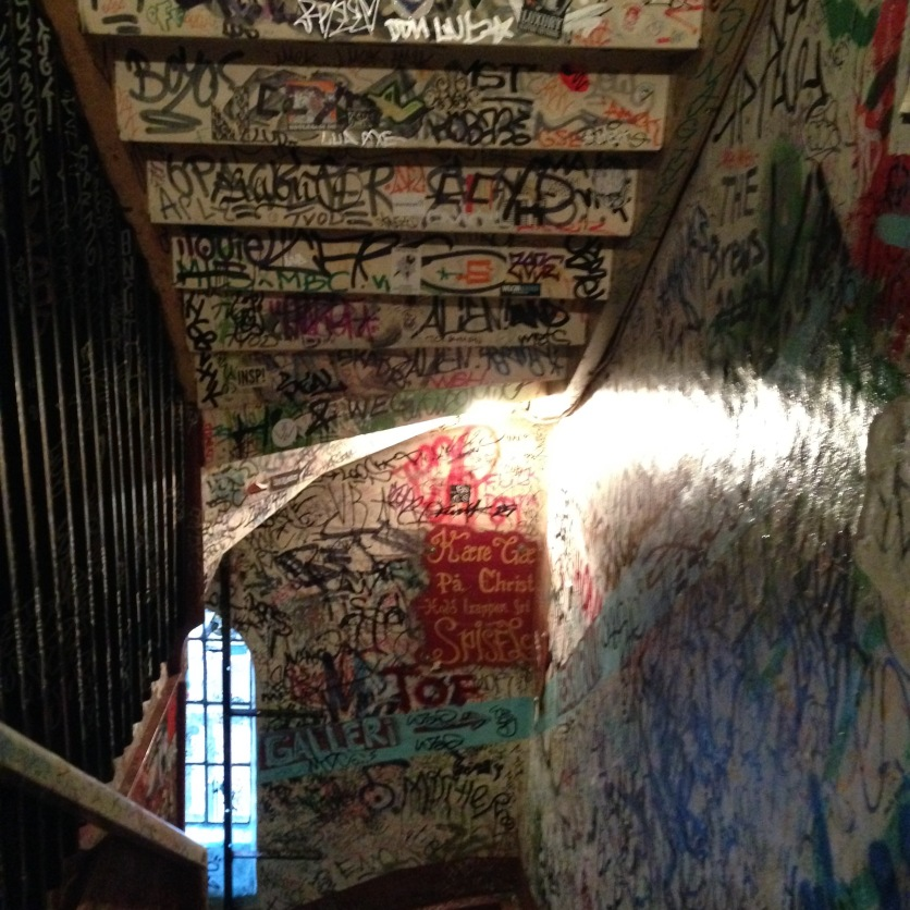Graffiti'd stairs lead to the restaurant