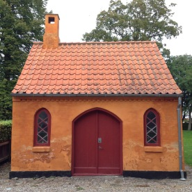 A delightfully small church outhouse