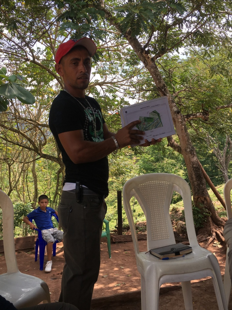 Juan Flores shows us his farm map