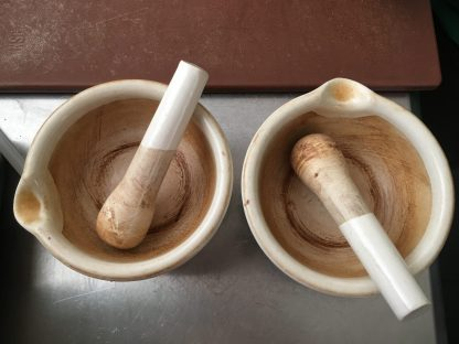 Pestles and mortars for crushing the beans