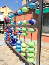 A giant glass blown abacus can be found down a side street